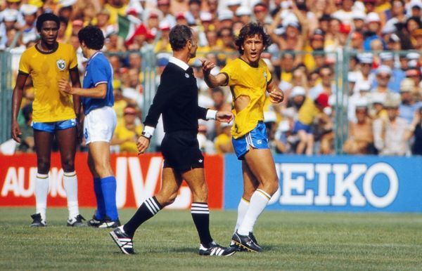 Brazil's Zico remonstrates with the referee after his shirt is ripped at the 1982 World Cup